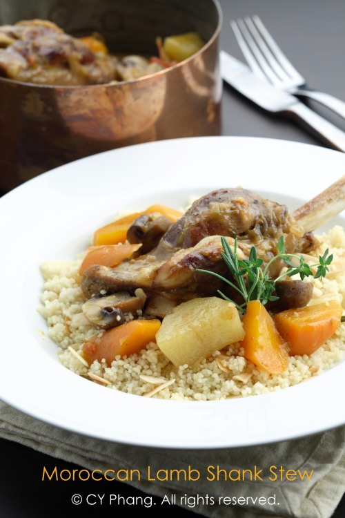 Lamb shank stew with vegetables, served with butter-almond flakes ...